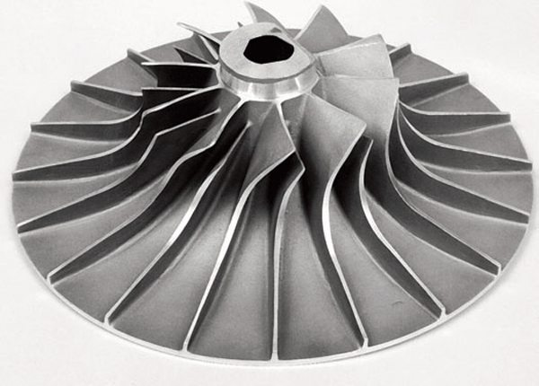 This is a typical centrifugal supercharger impeller. As you can see, air is drawn in through the center of the impeller and spun out through the blade tips.