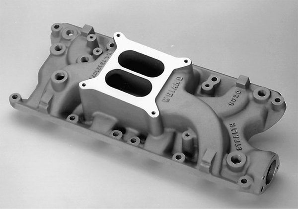 Street engines need to produce good lowend torque. To get there, they need a dualplane intake manifold like this Weiand Stealth cast-aluminum high-rise manifold. The Stealth has long intake runners, which help the engine make torque at lower RPM ranges.