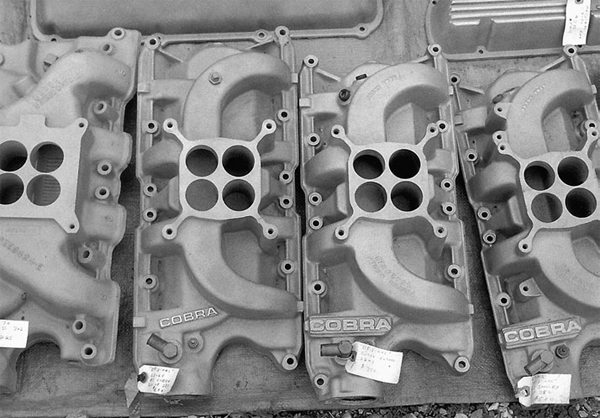 Swap meets offer a wealth of used highrise dual and single-plane manifolds. The older Cobra high-rise manifolds were based on the Edelbrock F4B high-rise of the 1960s and 1970s. They don't always come cheap, but they offer a period-specific look.