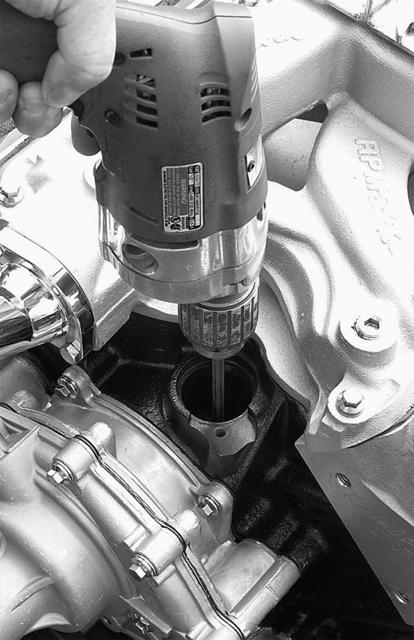 This is an oiling system primer for the small-block Ford. As you can see, it fits into the distributor opening in the block and splines over the oil pump shaft below. You will need a powerful reversible drill for this task.