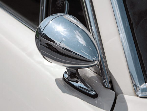 "The Rotunda ""bullet"" outside mirror was ambidextrous, not having a right-or left-side version (the same mirror could be mounted on either door). Some cars have had a right-side mirror added by a previous or current owner to ""balance"" the look of the car although the mirror's relatively small diameter (plus its far-forward location) would have rendered the effectiveness of a passenger-side mirror somewhat minimal."