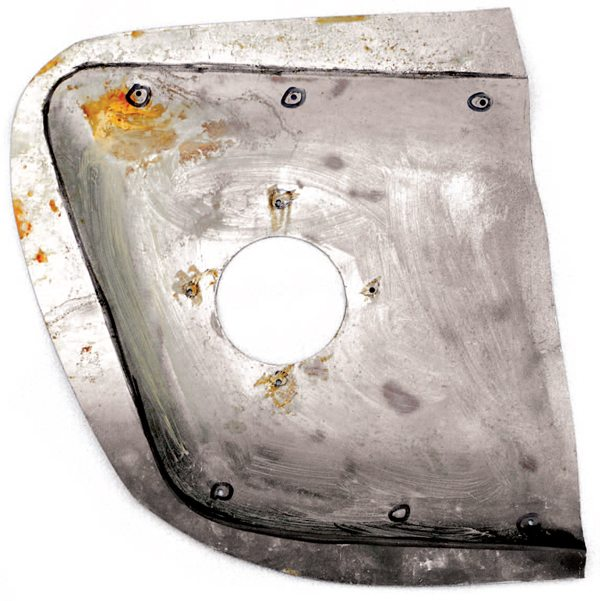 Usually hidden by the scoop and the blackout paint, a 3-inch-diameter hole connects to the internal ducting to funnel air to the rear brakes. The ridge line of the sculpted cut out is highlighted in black and the attaching holes for the scoop itself, as well as the flange connecting the internal duct are noted. There exists some documentation that Shelby American was contemplating a switch to bonded-on side scoops later in production, but it is not known if that plan ever came to fruition. Some evidence suggests that it might have, and was actually a combination of glue and a reduced number of rivets.