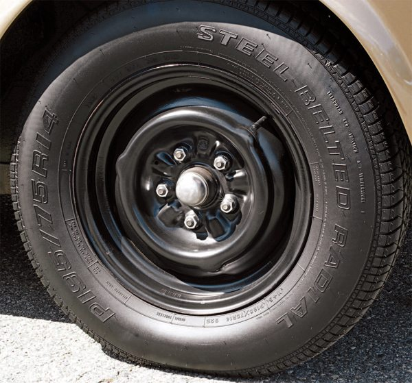 "Even after the decision to go to 14-inch-diameter wheels for the 1966 GT350 was made in principle, it took some time to find a supplier. In the interim, 1966 cars continued to use the Shelby Cragar wheel if a car was ordered with ""deluxe"" wheels (left). ""Standard wheel"" orders were filled first by 15-inch Argent-painted steel wheels, then later the same basic wheel in a 14-inch size, also painted Argent (right). Some 300 cars left San Jose rolling on 14-inch steel wheels, but it is not known how many of those had the wheels replaced by Cragars once they got to Shelby American."