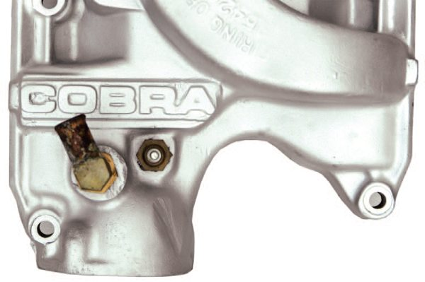 "One difference between the engines used in the 1966 near-specification GT350s and the full-specification cars is evident in two styles of COBRA aluminum intake manifold. 1965 and early 1966 engines received intakes with smaller COBRA lettering cast into them (top), while later intakes had larger lettering (bottom). The two types are, not surprisingly, known as ""small letter"" and ""big letter"" intakes. Shelby numbering scheme for the 1966 add-on parts included the prefix S2MS, standing for Shelby, Second Year, Mustang, Street."