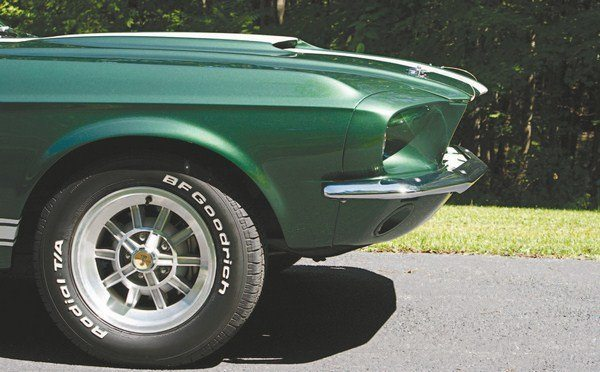 It was Carroll Shelby who, just before boarding a plane to France to give Ford their first-ever GT40 LeMans victory, insisted that the front end of the 1967 Shelby be extended several inches over that of the base Mustang to make the car look faster and sleeker. Even standing still, the new 1967 Shelby looked like it was going 100 mph and that was just the desired effect. To achieve this, fiberglass was used extensively to lengthen the nose over that of the Mustang, but the poor fit of the nose pieces caused stress for Shelby workers as they tried to attach the fiberglass parts.
