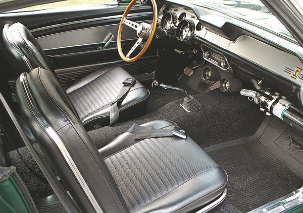 Unlike in years prior, where the Shelby cockpits could best be described as spartan, the 1967 Shelby interior was the first to be based on the deluxe Mustang interior. This meant plushier bucket seats with hard plastic backs and stainless-steel trim bordering the backs and sides. Not only did the seats look plushier, but they had a corresponding feel as well. Dash and door trim made liberal use of brushed-aluminum panels and like in the 1966 pony interiors, door panels had molded-in arm rests and door pulls. Extruded aluminum lower door grilles with courtesy and safety lights rounded out the trim. A remote driver-side mirror and day/night rearview mirror were part of the interior package as well.