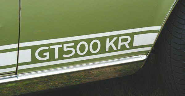 The Shelby trademark Microgramma Extended Bold font did not allow the GT500 KR designation to fit on the fender bottom (one or two prototype cars were simply lettered 500 KR in Microgramma), so a change to Sans Copperplate Gothic Bold for that model Shelby was implemented (GT350 and GT500 lettering stayed in Microgramma).
