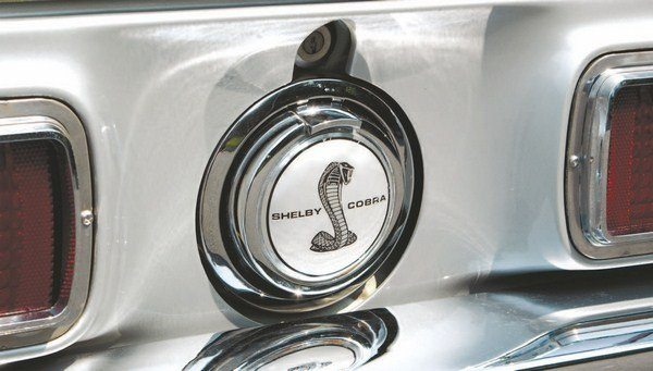 The same Mustang flip-open gas cap returned to the 1968 Shelby, modified from the Mustang part with the addition of a glued-on foil decal. The decal was almost identical to the 1967 decal, although the lack of the GT350 and GT500 lettering meant that only one decal was needed for 1968 production.