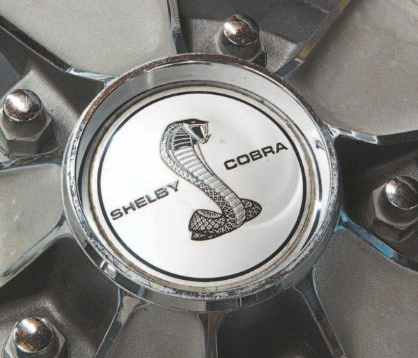 While the Garwood wheel cover was not Shelby-unique, the versions used by Shelby were, using a special domed center cap that accepted the Shelby fuel cap decal. GT500 KR cars used the COBRA JET decal on their wheel covers while 500s and 350s got the SHELBY COBRA logo.