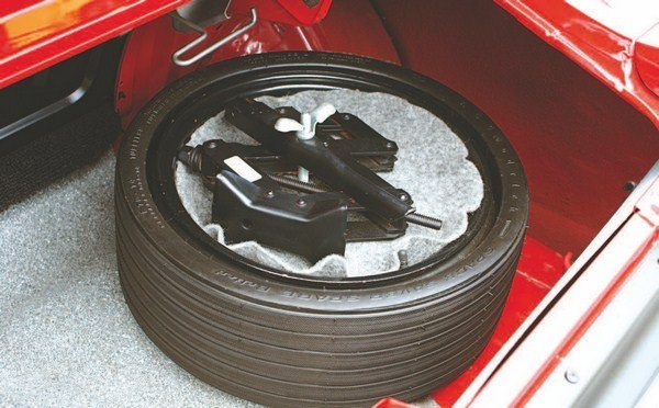 To maximize trunk space, an inflatable space-saver spare tire resides in the traditional spare tire location.