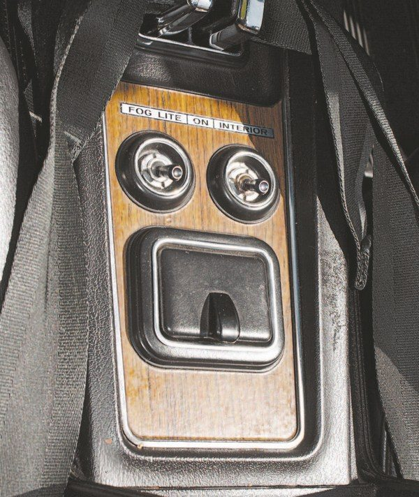 "The rear portion of the center console contained switches for fog and interior lites (note abbreviated spelling of ""lights""). Although the lights were actually highintensity driving lights, they were labeled as fog lights."
