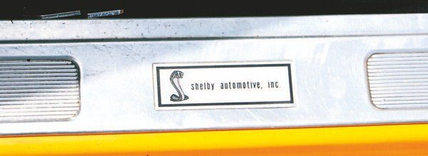 "A tag with ""Shelby Automotive, Inc."" lettering was attached to the door sill scuff strips. The same basic snake graphic was used since it first appeared on 1967 door sill tags, and 1969 was the only year Shelby utilized the same doorsill label style throughout the entire year's production."