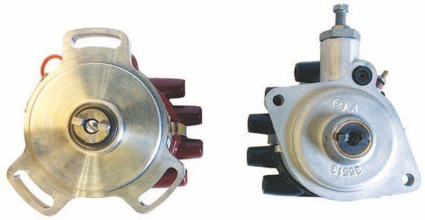 The mounting side of these distributors clearly shows the 1932–1941 three-hole mounting style on the left and the 1942–1948 two-hole style on the right. The three-hole is a modern billet assembly, whereas the two-hole is an original distributor.