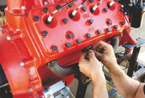 Mike installs his fire-up stand headers. He doesn't bother with gaskets while performing the fire-up test. You will need gaskets, which are available from a number of sources. SCE Gaskets offers embossed copper gaskets.
