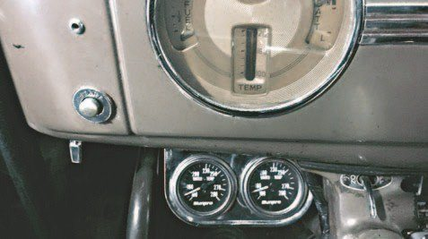 Because the flathead has two pumps, Theresa chose to mount dual water temperature gauges below the dash. (Photo Courtesy Debbie Davis)