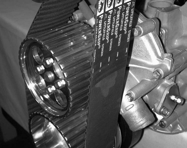 Another advantage of the Ford small-block Kuhl Supercharger system is the cog belt pulley that drives the water pump, which considerably simplifies things. Kuhl's smallblock Ford setups also use the damper to reduce crank belt vibration, lengthening the service life of the crank snout and the balancer.