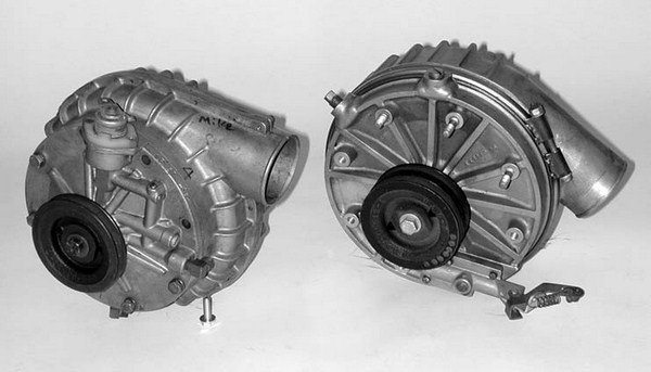 Shown here are examples of the NASCAR version and street version of the McCulloch VR-57 ball-drive centrifugal supercharger. The blower on the left is the Daytona NASCAR version, which was briefly used by the Ford teams (1957) prior to its being outlawed. The unit on the right is the street version (with 3.5:1 to 5.5:1 step-up ratio) that was successfully used on the 1957 Ford Blower Bird, of which a total of 211 cars were built.