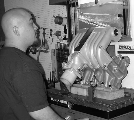 1. With an engine this big we need all the airflow we can get. Extrude Hone AFM technician Willie Melendez initially tested our intake to come up with a creditable baseline to work from.