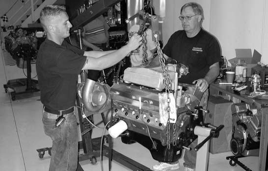 51. Tom Habryzk and Westech Performance CEO John Baechtel prepare to install our 408 onto the dyno for the first time. Setup is understandably time consuming. All told, about 6 hours were required prior to getting our big-inch Ford to cackle.