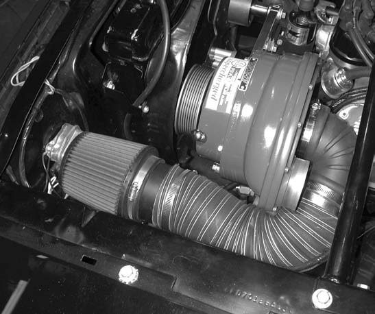 14. Next comes installing the drivers-side supercharger air intake duct and K&N conical air filter assembly.