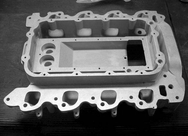 Shown is Kenne Bell's own manufactured 4.6L DOHC 4-valve intercooler intake manifold, which is an integral component in an intercooled Kenne Bell 4.6L Ford modular engine twin-screw supercharger kit.