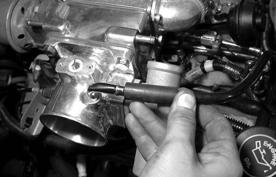 19. The breather tube assembly is hooked up, which runs between the valve cover and the EGR spacer plate.