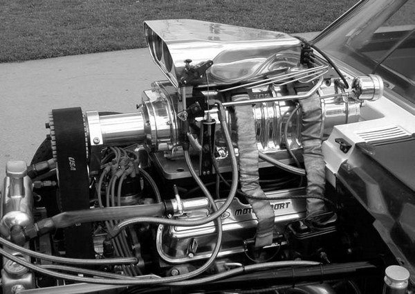 "Other approaches to street supercharger induction systems include the use of a conventional ""bug catcher,"" or a two- or four-hole fuel injector housing like those used on the old gasers or dragsters, along with a dry supercharger and digitally controlled electronic fuel injection."