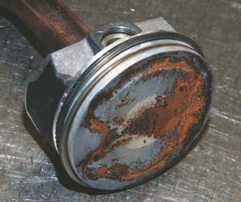 The Coyote piston, shown from another angle, demonstrates how different this slug is from those in the 4.6L/5.4L Modular. It is a lighter piston sporting a protective coating, enabling it to survive higher-combustion temperatures.