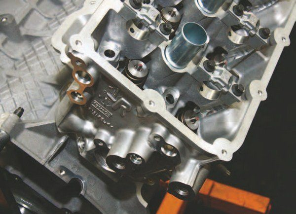 """This is the right-hand (passenger) head, with an """"R"""" (for """"right"""") and the Ford casting number. At least four cylinder-head castings are available at press time: 2011–2014 standard head, 2012–2013 BOSS 302, 2015–2016 CMCV, and the GT350 head."""