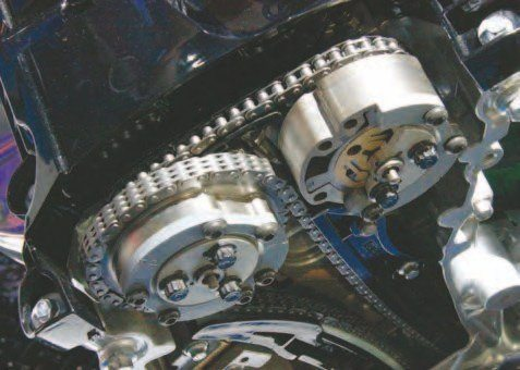 Cutaways of the Ti-VCT oil-pressureoperated cam actuator sprockets show a pin at the center of each sprocket/ actuator, which is operated by the Ti-VCT solenoid (electromagnet) and PCM.