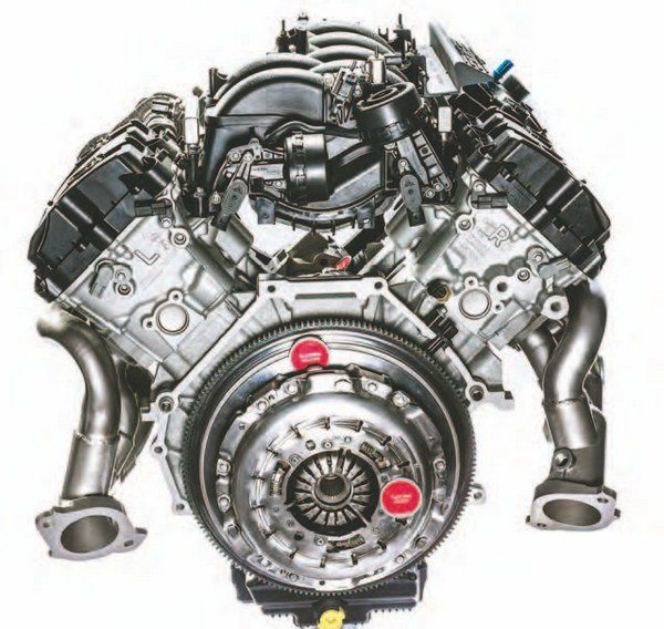In back, the 5.2L Voodoo has a dual-mass flywheel, charge motion actuators, and a more advanced induction system. This is easily the most advanced intake manifold in Ford history, with the focus being high-RPM operation. Low-end torque isn't what this engine is about. It is race bred and born for Mustang. (Photo Courtesy Ford Performance Parts)