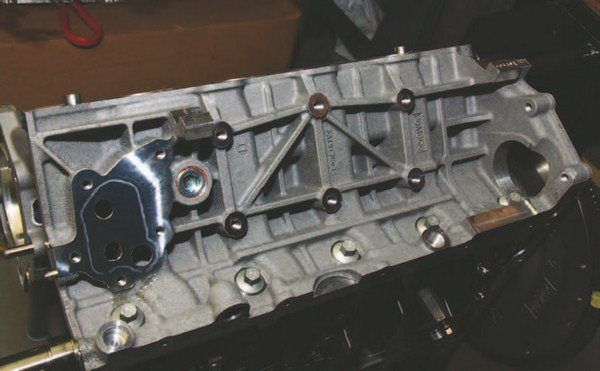 Performance enthusiasts like the Coyote block with its extensive network of ribs and beefcake support, which means strength and durability. These left-side (driver) block casting ribs and gussets provide unprecedented strength across block decks and pan rails. Cross-bolted main caps with interference fit provide the security of Fort Knox. One weakness has been among 4- and 8-cylinder bores, which have experienced cooling problems and blown cylinder walls. Improved coolant flow at the back of the block and heads can solve this problem.