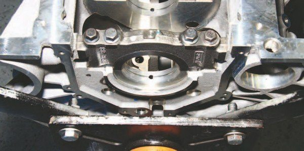 It used to be that rear main seals were integral with the five-main-bearing cap; not anymore. The rear main seal is fitted into a bolt-on cast-aluminum aft block cover, which is separate from the five-main-bearing cap, which makes rear main seal replacement easier and ensures a more leak-proof seal.