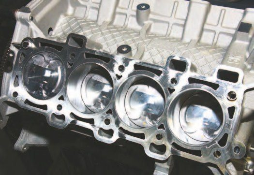 This is a stock 5.0L Coyote short-block with hypereutectic 11.0:1 pistons and powdered-metal rods. It is remarkable how well this engine endures in stock form under extreme abuse in the 400- to 600-hp range.