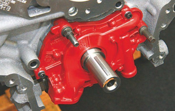 The high-performance steel billet oil pump from Modular Motorsports Racing improves durability. It is red for identification and employs the factory pump housing. What makes it different are billet steel internals for durability.
