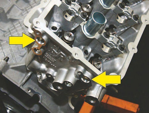 """This is a right-hand (passenger) cylinder head on a 2015 Coyote, as indicated by the """"R."""" As with the left-hand (driver) cylinder head, there are intake and exhaust cam sensor ports."""