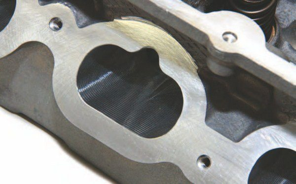 The 2011–2014 head has a shorter intake port flange. This is also a CNC-machined intake port. The stock port is roughcast.