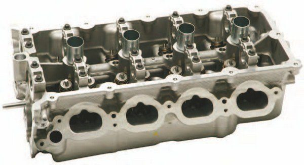 This is the 2012–2013 BOSS 302 cylinder head casting, M-6050-M50 and M-6049-M50 (shown), which really is a different casting of an improved 356 aluminum alloy (versus 319 with base Coyote heads) with CNC-machined ports and chambers. According to Ford, there's a measure of copper in the 356 alloy, which improves heat transfer under extreme conditions. (Photo Courtesy Ford Performance Parts)