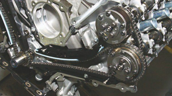 The Coyote V-8 employs a similar camshaft drive system to the 4.6L and 5.4L DOHC engines with a timing chain for each bank, which drives the exhaust cam. A smaller secondary chain between cams drives the intake cam.