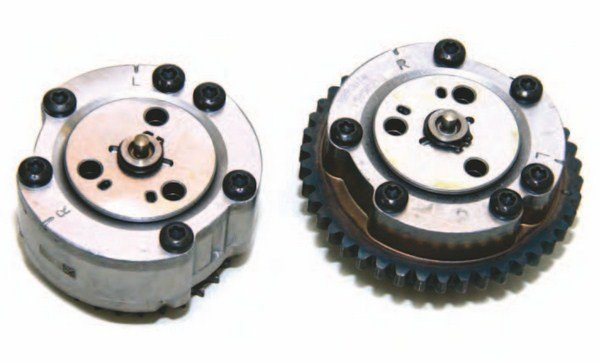 """Cam sprocket phasers advance cam timing as solenoids actuate a button in the middle of the phaser, which is valved to modulate cam movement. These phasers are interchangeable from side to side. These are 2011–2014 phasers. The 2015–2016 phasers are different in both appearance and function. The """"R"""" and """"L"""" timing marks are left- (driver) and right-bank (passenger) installation."""