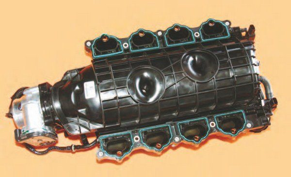 Here's the CMCV intake manifold from underneath. Charge Motion for 2015–up isn't the old butterfly valve approach to changing manifold runner length. Instead, it's a flapper system that swings out of the way, eliminating all airflow interference issues.