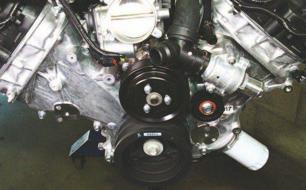 "The Coyote's cooling system is simple in scope, as shown here. Coolant recirculates within the engine in a conventional fashion via the plastic ""Y""-pipe when the thermostat is closed. When the thermostat opens, fresh coolant flows into the engine from the radiator via the lower radiator hose. Hot coolant exits the engine via the ""Y""-pipe and upper radiator hose."