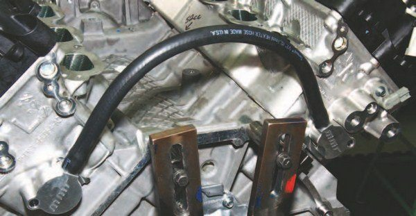 The Coyote's only cooling issue, which can also be considered a weakness, is hot spots at the back of the block and heads, primarily, under high boost or nitrous. If you are running a lot of boost or nitrous, cylinders number-4 and -8 can fail due to extreme heat in these areas and insufficient cooling. The result is blown-out cylinder walls and catastrophic engine failure. Modular Motorsports offers this kit designed to improve coolant circulation at the back of the engine, which saves cylinder walls.